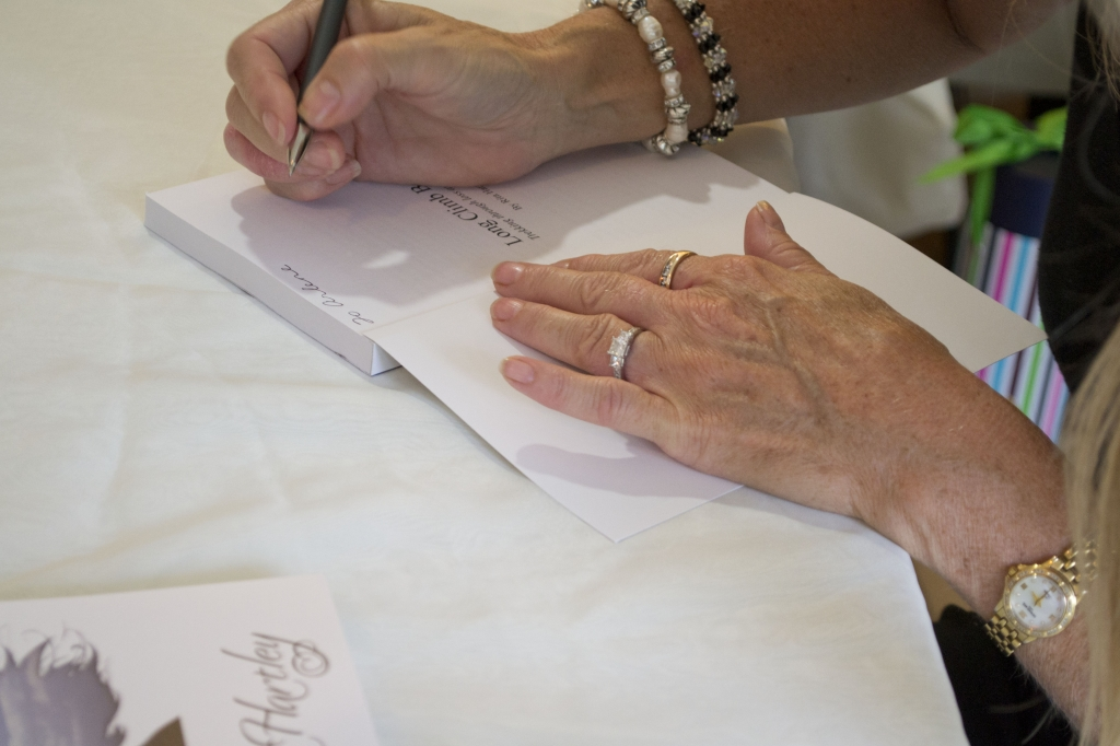 book signing image of Rita's hands