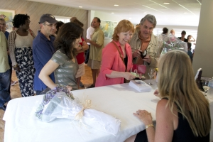 Rita signing copies of Long Climb Back for the attendees of her book launch