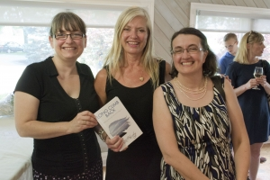Rita Hartley posing with her book designer Carolyn McNall and editor Simone Graham