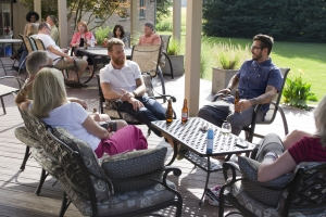 Friends and family move the party outdoors to the deck area